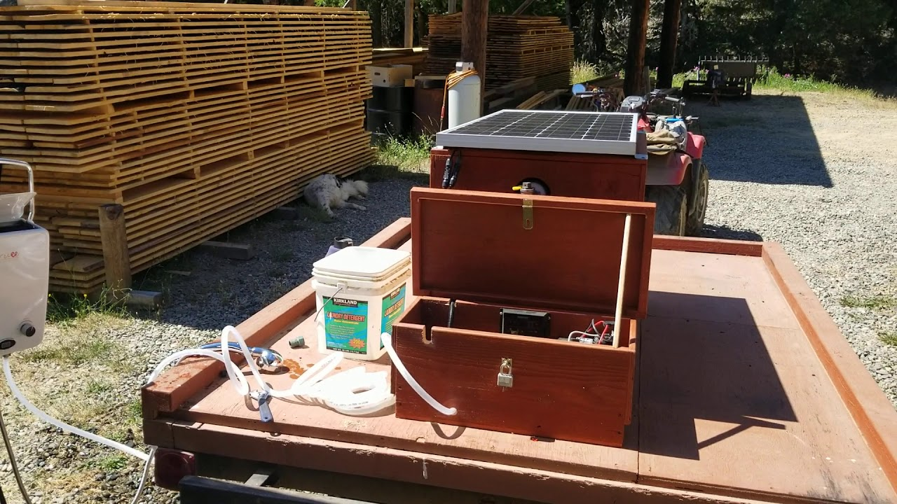 Solar powered water tank and propane water heater.