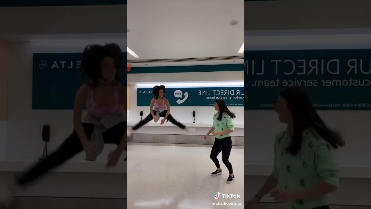 Charli Damelio dancing in the airport... - YouTube