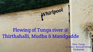Tunga river when heavy rainfall & it reaches alarming level