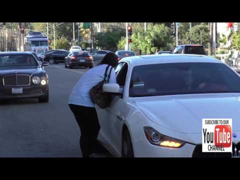 Brittny Gastineau and Mary Teigen stop to talk in middle of the road in Beverly Hills
