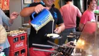 Hong Kong Street Food. Egg Waffles (Gei Dan Jai) in Cheung Chau (an Hong Kong outlying island) thumbnail