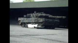 Leopard 2 Battle Tank drives over a car Video