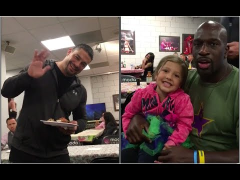 Titus O'Neil and Roman Reigns' little cousin backstage at RAW