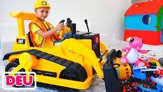 Vlad und Nikita spielen mit Spielzeugen und fahren mit dem Bagger