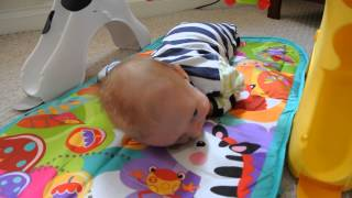 Tummy time on The Fisher-Price Newborn to Toddler Gym