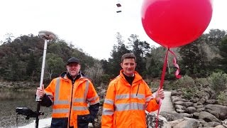 Using a big red balloon to demonstrate flood heights - Launceston floods