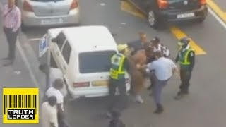 South African police kick and slap naked man in the groin - Truthloader