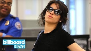 Camila Cabello Entertains Airport Paparazzi With Hilarious Poses | Billboard News