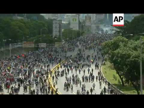 Venezuelan police fire tear gas at protesters