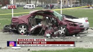 Two dead after Camaro goes airborne, lands on top of Malibu in Detroit