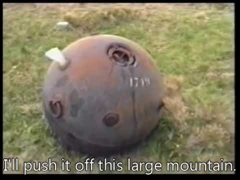 Pushing a naval mine off a mountain