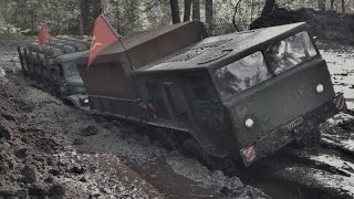 rc axial scx10 8x8 maz 537 and 6x6 kraz 255 in the mud