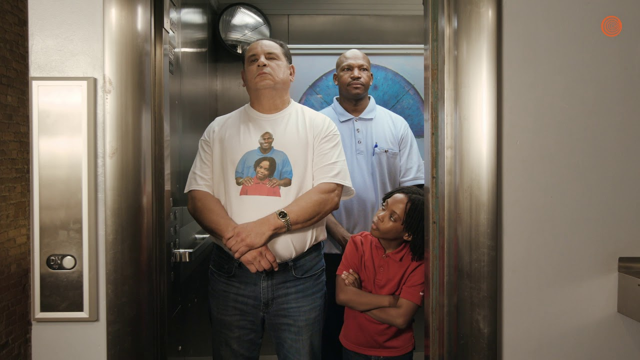 awkward people in elevator. awkward: father and son forced to share an elevator with a stranger who is wearing shirt of them awkward people in