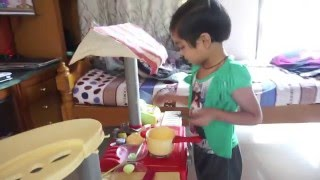Cute baby cooking