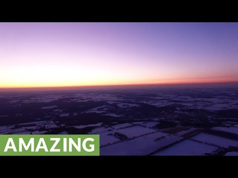 Spectacular winter sunset filmed by high altitude drone at 2,000 feet