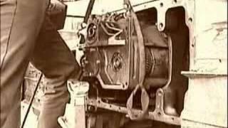 John Deere 450 LPG Dozer transmission installation in Shop