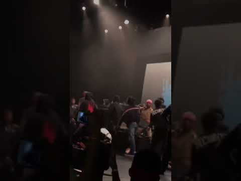 Rapper gets knocked out and carried away by bodyguards.