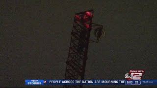 3 men arrested for climbing transmitter tower downtown