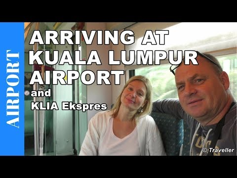 Arriving at Kuala Lumpur Airport, Malaysia & KLIA Ekspres train to the city - Airport Video