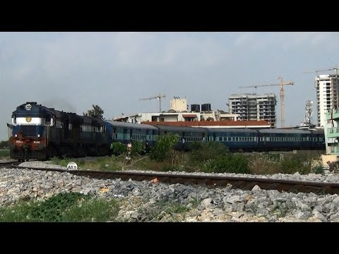 Train through Bangalore buildings - Coimbatore Express.