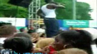 Rapper Akon tosses a fan off of the stage after he hits him with a bottle    Vidmax.com.flv