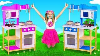 サーシャはマクドナルドのレストランを開き、台所のおもちゃで調理することを学びます