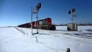 CN/EJ&E 666 SD38-2 speeds East with empty centerbeam flat cars