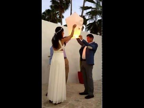 LanternsandMore - Lighting A Wishing Sky Lantern - Beach Wedding