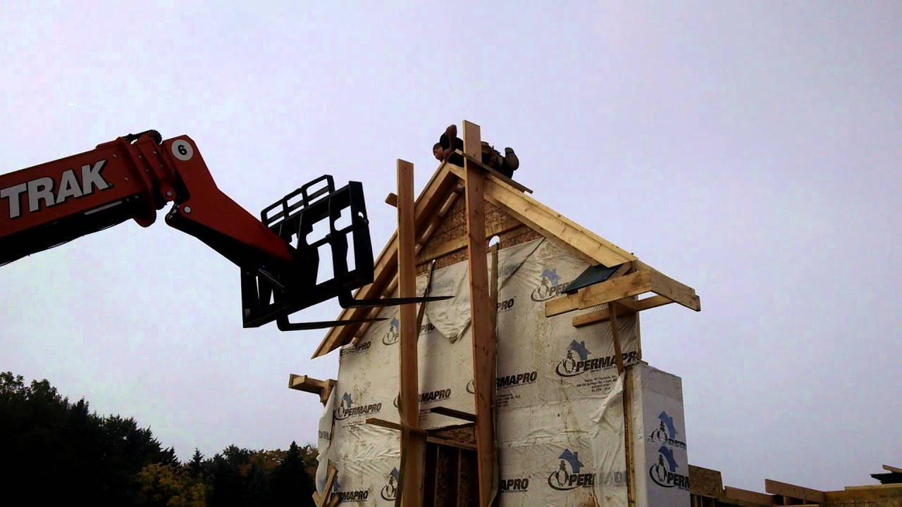 Sebring building company framing for a new luxury home in for Home building companies in michigan