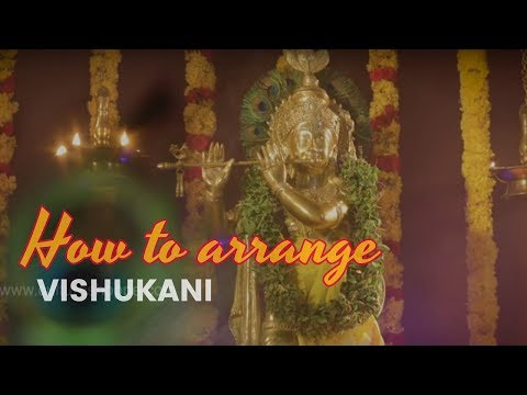 Arranging Vishukkani, the set of auspicious objects