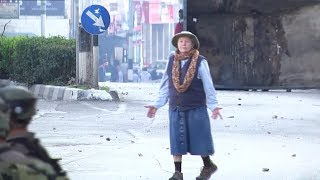 RAW: Fearless grandma puts herself between IDF and Palestinian protesters