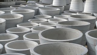 Pan shot of ready cement planters (Gamla) kept for selling