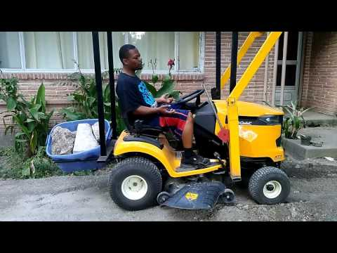 Riding lawn mower with front end loader Cub cadet XT1