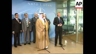 Iraqi interim president meets NATO chief