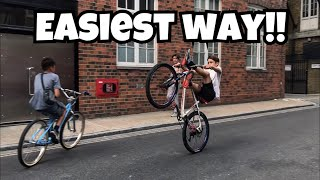 HOW TO WHEELIE A BIKE!!