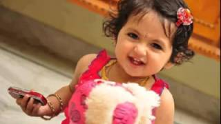 A cute girl singin malayalam super song oru murai vanth parthayaa.....