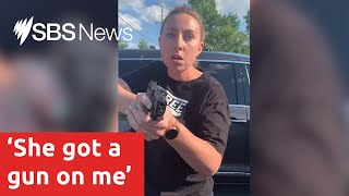 Woman pulls gun on black mother | SBS News