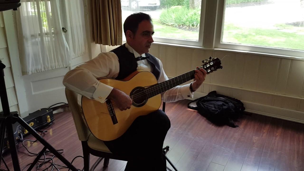 STAN WIEST MUSIC 631 754 0594 SPANISH GUITARIST PLAYING BOSSA NOVA FOR WEDDING COCKTAIL HOUR