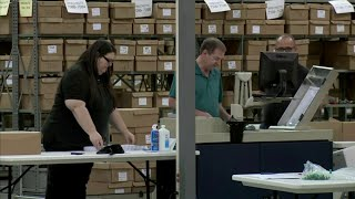 Palm Beach County vote counters deal with machines overheating