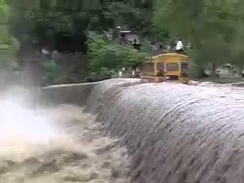 Bus Crossing Flooded Bridge in Nicaragua
