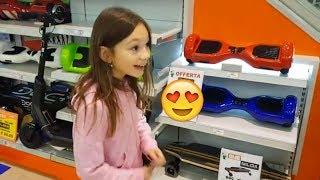 Покупаем гироскутер hoverboard.Катаюсь по магазину.Много игрушек/Аврора купила куклу балерину.