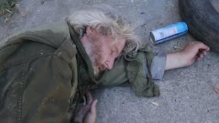 Guy pees on homeless dude.