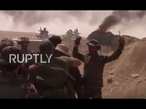 Syria: See SAA soldiers embrace after finally breaking IS siege of Deir ez-Zor *EXCLUSIVE*