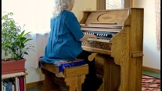 """Spinning Song"" played on antique reed pump organ"
