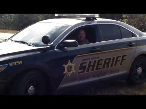 MOBILE COUNTY SHERIFF DEPUTIE GANGSTALKING WITH OTHER KKK COPS IN BUSHES WITH RIFLE
