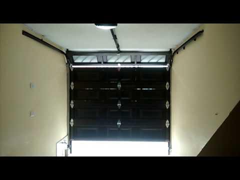 Puerta de garaje electrica interior bogota colombia youtube Puertas corredizas seguras