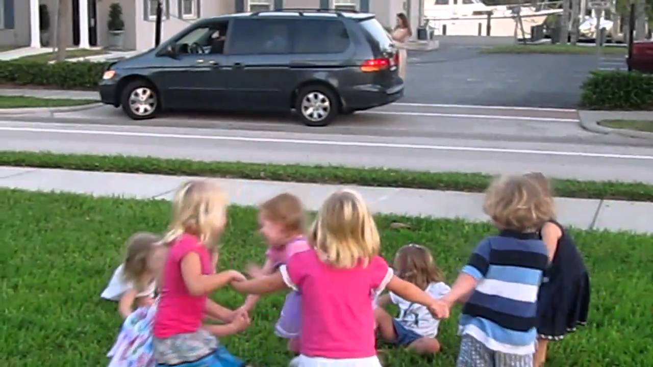 Minnie Collins Playing Ring Around The Rosie With Kids In