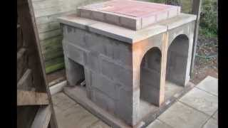 Pizza oven construction .Traditional Italian wood burning method.and smoker.