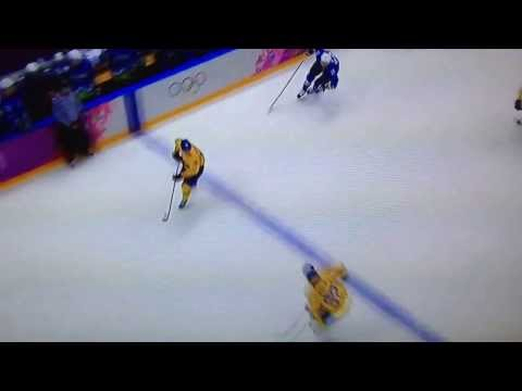Carl Hagelin Gets Crushed by Slovenia's Sabahudin Kovacevic
