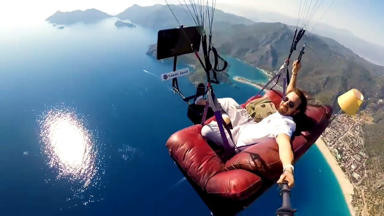 Guy Paraglides With Sofa and TV Set